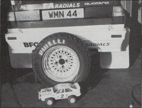 Tamiya Audi Quattro sitting beside real Audi Quattro rally car, RAC Rally 1984