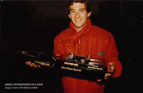 Ayrton Senna holding his JPS Livery Asahi R/C Boat, 1986